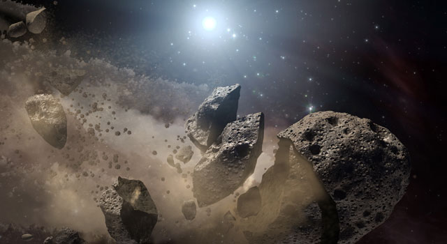 Artist conception of the breakup of an asteroid into separate family members.