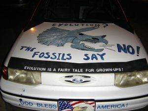 A car seen in Athens Georgia.  I don't know who the owner is but it is very likely they know very little about geology.  It is more likely that they have placed their faith in the experts at AIG. That trust in experts has emboldened this person to proclaim their belief in scientific evidence on their car.   (image credit: Wikipedia.org)