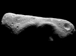 Eros asteroid.  Despite its oblong shape it has been shown to be rotating around is principle axis point.