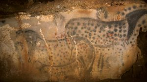 A photo from the Pech Merle Prehistory Center shows a cave painting of pair of spotted horses, found in the Pech Merle Cave in Cabrerets, southern France. Scientists estimate the drawing, measuring about four metres wide by 1.5 metres high, is about 25,000 years old. Source: AP