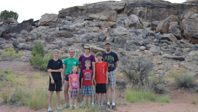 Yep, I dragged the whole family along on this adventure. Here we are standing in front of the small ridge the contains dinosaur bones and plant fossils.  The fossil part is near the very top section that you see in the background. Photo Credit: Joel Duff