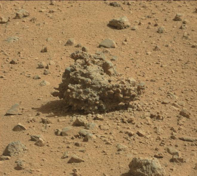 A lonely decaying piece of conglomerate rock lays on the surface of Mars in Gale Crater.   This is from SOL373 on Mars taken by the Curiosity rover.   Image credit: JPL/NASA-CalTech