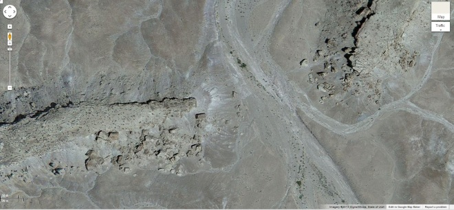 Inverted/raised paleochannel as seen on Google maps.  in this close-up you can see the hardened rocks of what used to be the stream channel that are now about 100 feet above the surrounding landscape.