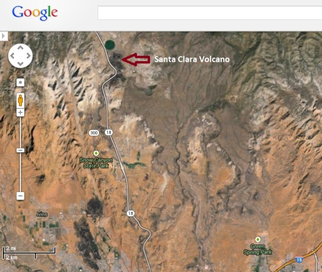 Santa Clara volcano north of St. George. From its source the lava flowed down into the valley and eventually formed the lava fields you can see as dark patches in the lower portion of the image.  Google and the Google logo are registered trademarks of Google Inc and used with permission.