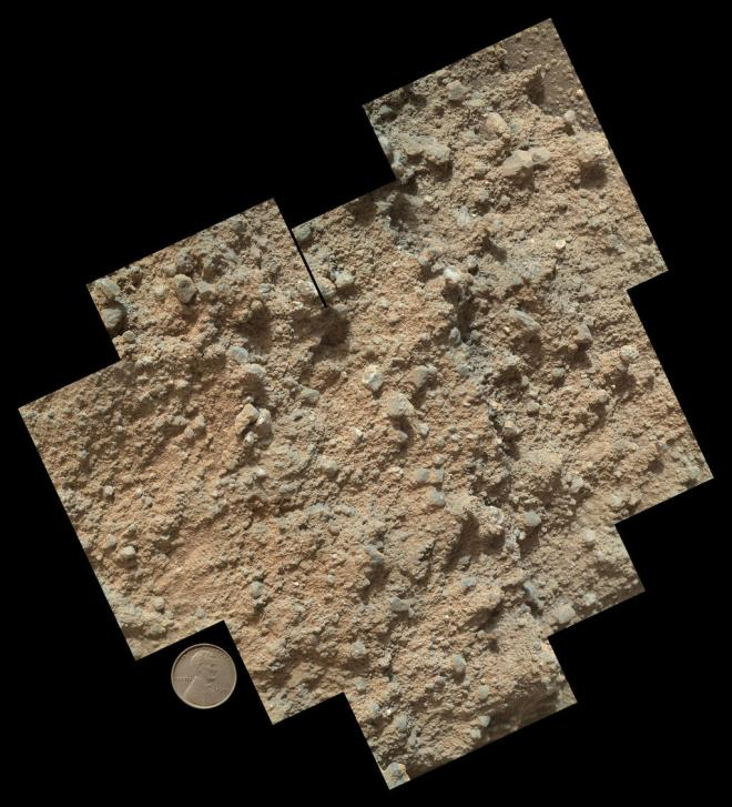 The microscope images took a series of pictures of a layer of what is clearly another conglomerate rock.  Image: JPL/NASA-Caltech