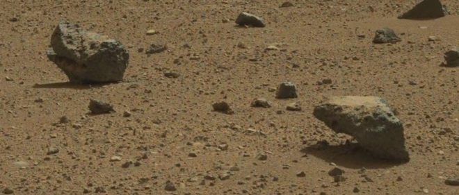 An interesting rock stands on the surface of Mars waiting for something to come along and tip it over.  Image credit:  JPL/NASA-CalTech