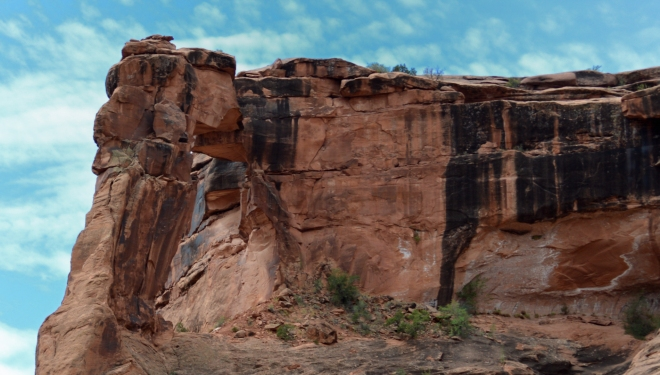 Desert varnish on rocks around arch in Hunters Canyon near Moab UT.  Image: Joel Duff