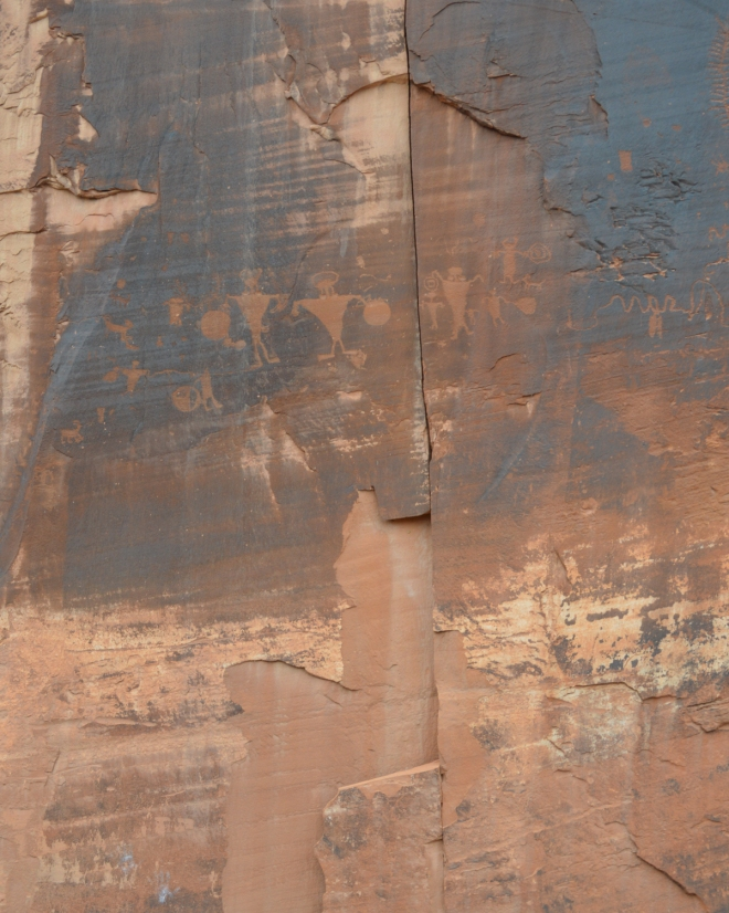 Petroglyphs etched into desert varnish along the Colorado river just west of Moab UT.  Image Credit: Joel Duff