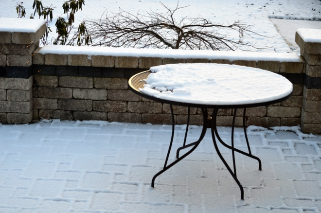 An puzzling pattern of disrupted snow is seen on our patio table the morning of Christmas eve.  Image Credit: Joel Duff