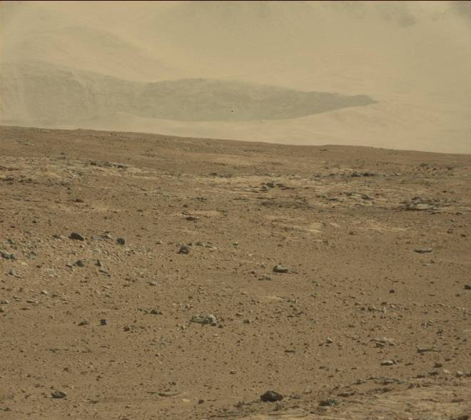 An ancient crater at the base of the Gale crater walls is visible in the distance.  Image: JPL/NASA/MSSS