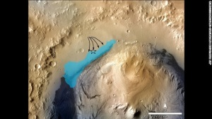 Gale Crater showing position of proposed aluvial (river) deposits and ancient lake system.  I have added the approximate position of the rover (star) and large crater that it can now see in at the base of the Gale crater wall (arrow down).  Image from NASA/JPL/Caltech