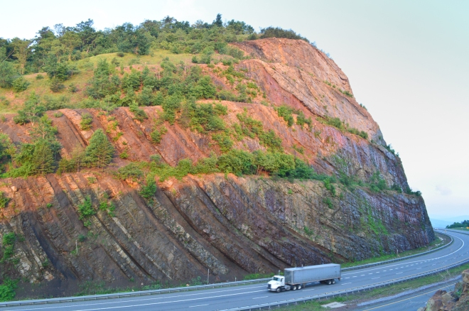 Sunrise hits the southside rocks of the Sideling Hill road cut along I-68.  I took this picture with the truck for scale. Image: Joel Duff