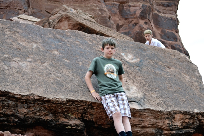 Dinosaur footprints on a block of rock that became dislodged from higher above. Two of my boys are serve as size references. Image: Joel Duff