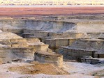 Eroson of Lake Lisan sediments.  http://www.efratnakash.com/galleries_l_pics/israel/the_dead_sea/13-4313.jpg