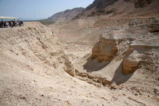 Lake Lisan deposits near Qumran caves.  These layered rocks in the foreground represent sediments that were laid down during very high stages of Lake Lisan. Later this rock was eroded by streams cutting through the soft rocks. Image: