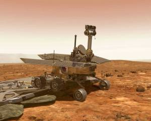 Artistic impression of Opportunity rolling off its lander onto Mars for the first time.