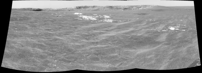 Coming up on Endurance crater. The crater wall on the far side is just visible for the first time.  Image credit:  JPL/NASA-CalTech