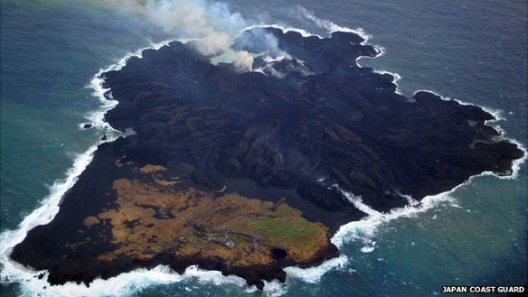 In March of 2014, the volcano has about half-covered the original island. The light green in the foreground is vegetation cover of parts of the island formed in 1973.