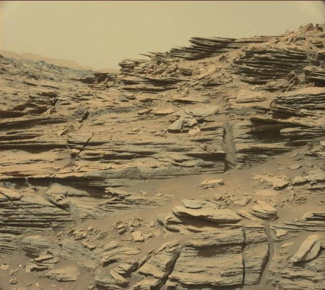 A hillside with thousands of wafer-thin layers of rock on Mars.  Taken by the Mars Curiosity Rover.  Image: JPL/NASA-Caltech 2015