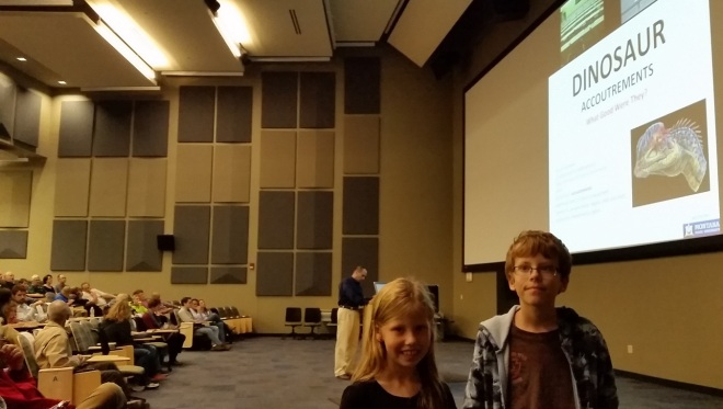 """A couple of my kids before Dr. Horner's talk """"Dinosaur Accoutrements"""" began. Image: Joel Duff"""
