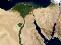The Nile Valley is easily seen against the barren deserts of Egypt.