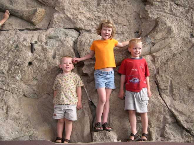 Some of my kids posing in front of dinosaur bones exposed at Dinosaur National Monument more than 10 years ago.
